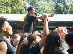 Khan pumps up students at Senior Unity Day. Photo courtesy of Paloma Zegarra
